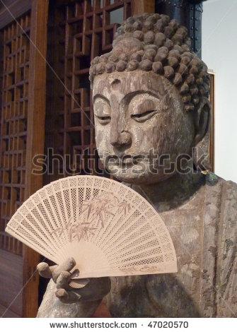 stock-photo-ancient-asian-buddha-holding-fan