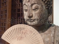 stock-photo-ancient-asian-buddha-holding-fan